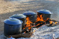 Cowboy Beans simmer on a bed of coals Royalty Free Stock Photo