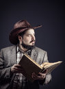 image photo : Cowboy with book