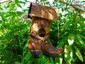 Cowboy boot bird feeder photographed in the state of vermont Royalty Free Stock Photography