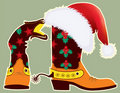 Cowboy boots and Santa's red hat for design Stock Image