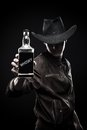 Cowboy with bottle of whisky Royalty Free Stock Photos