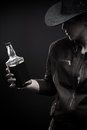Cowboy with bottle of wisky Stock Images