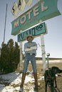 Cowboy with dog stand in front of Sands Motel sign Royalty Free Stock Photo