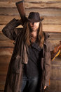 Cowboy duster long hair rifle behind back a with his on and a his Royalty Free Stock Photography
