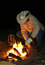 Cowboy By The Fire Before Dawn Royalty Free Stock Images