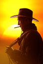 Cowboy hat cigar lasso silhouette Stock Photography