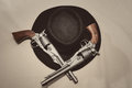 Cowboy hat and pistols from a Royalty Free Stock Images