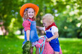 Cowboy kids playing with toy horse Royalty Free Stock Photo