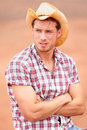 Cowboy man handsome and good looking with hat in rural usa countryside male model in american western prairie landscape nature on Stock Image