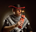Cowboy mexican firing dynamite by cigar serious Royalty Free Stock Images