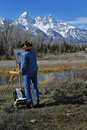Cowboy painting teton mountains Royalty Free Stock Photography
