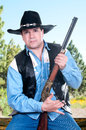 Cowboy pointing a rifle Stock Photography