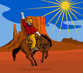 Cowboy riding a bucking bronco Stock Photo