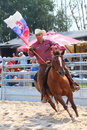 Cowboy riding with slovakian flag unidentified in a opening ceremony at the international rodeo show strabag prorodeo tour on Stock Image