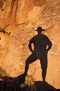 Cowboy shadow on rock Stock Images