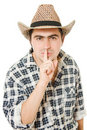 Cowboy shows the silence Stock Photos