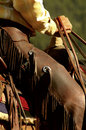 Cowboy side view of on horse Stock Photo