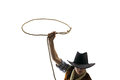 Cowboy throws a lasso white isolated on the background Royalty Free Stock Photo