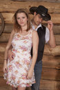 Cowboy touch hat holding woman a on to his he is touching the brim of his Royalty Free Stock Photo