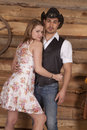 Cowboy with woman arms around him Royalty Free Stock Photography