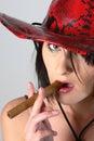 Cowboy woman smoking cigar Royalty Free Stock Images