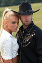 Cowboy and woman in western wear Royalty Free Stock Photography