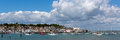 Cowes harbour isle of wight with boats and blue sky panorama white clouds in panoramic view Stock Photography