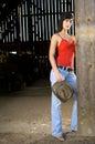 Cowgirl in barn doorway Royalty Free Stock Photo