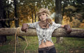 Cowgirl cowboy girl with a cigar in cowboy shirt and hat outdoors photo of white woman wearing Royalty Free Stock Images