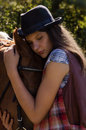image photo : Cowgirl in hat with bay horse