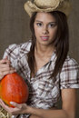 Cowgirl and her squash Stock Photo
