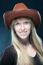 Cowgirl portrait of a young blonde in a cowboy hat Stock Photos