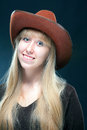Cowgirl portrait of a young blonde in a cowboy hat Stock Photography