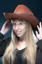 Cowgirl portrait of a young blonde in a cowboy hat Royalty Free Stock Photography