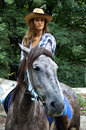 Cowgirl rides a horse Stock Photo