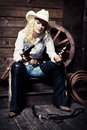 Cowgirl in the stables Stock Photos
