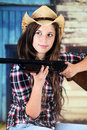 Cowgirl taking aim a pretty teen with her rifle Stock Images