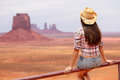 Cowgirl woman enjoying view of monument valley wearing cowboy hat beautiful young on sitting looking outdoors arizona utah Royalty Free Stock Photos