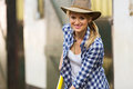 Cowgirl working stables happy in Stock Image