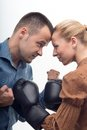 Coworkers in boxing gloves young attractive business women attacking men with fists isolated on white background Royalty Free Stock Photography