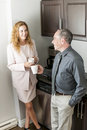 Coworkers on coffee break man and women having conversation in office area Royalty Free Stock Image