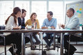 Coworkers discussing in meeting room Royalty Free Stock Photo