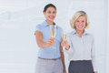 Coworkers holding flutes of champagne at work Stock Images