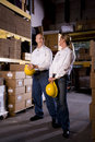 Coworkers in office storage room Royalty Free Stock Image