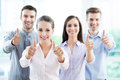 Coworkers showing thumbs up young business people Royalty Free Stock Photography