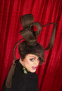 Coy drag queen caucasian with ponytails in theater Royalty Free Stock Images