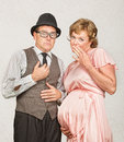 Coy pregnant couple embarrassed european male next to woman Royalty Free Stock Photos