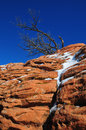 Coyote buttes red rock with snow with blue sky Royalty Free Stock Image
