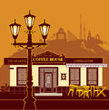 A cozy coffee house and view of the city evening Stock Images