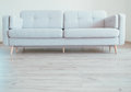 Cozy contemporary scandinavian Style Sofa on the oak laminate flooring Royalty Free Stock Photo